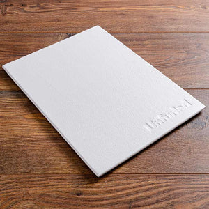 luxury leather menu board in white leather with embossed logo on the front cover for luxury yacht