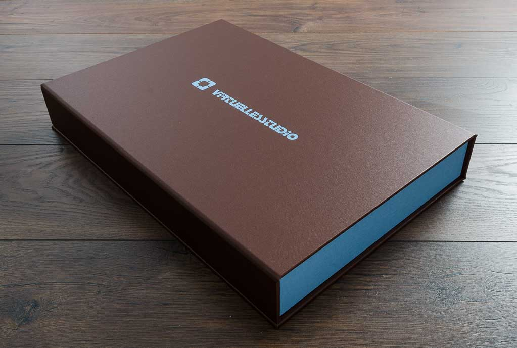 A3 Half clamshell box in Cornerline buckram with blue foil personalisation