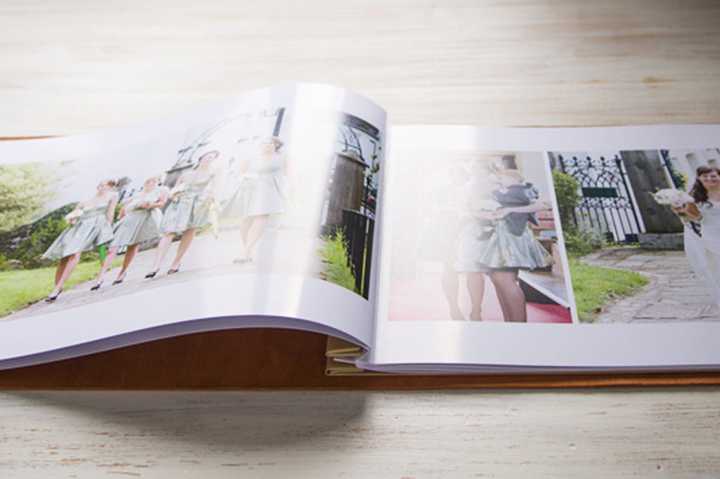 wedding album photographers in leather portfolio