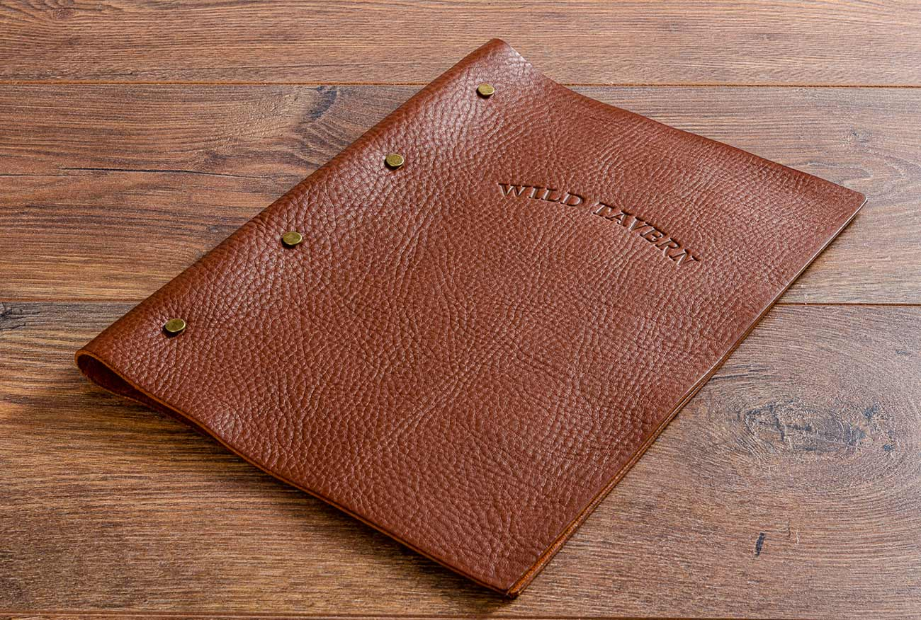 A4 leather menu in 2.5mm veg tanned medium brown leather with bebossed personalised cover
