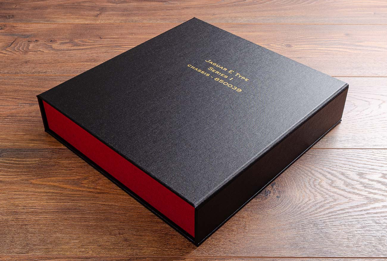 Custom made clamshell box file with gold foil embossing for E Type Jaguar
