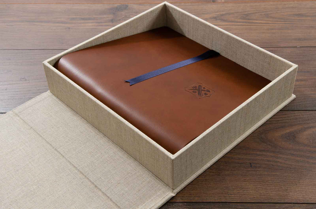 The clamshell book box houses a leather portfolio binder