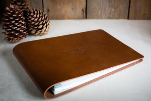 brown leather wedding guest book with personalised cover