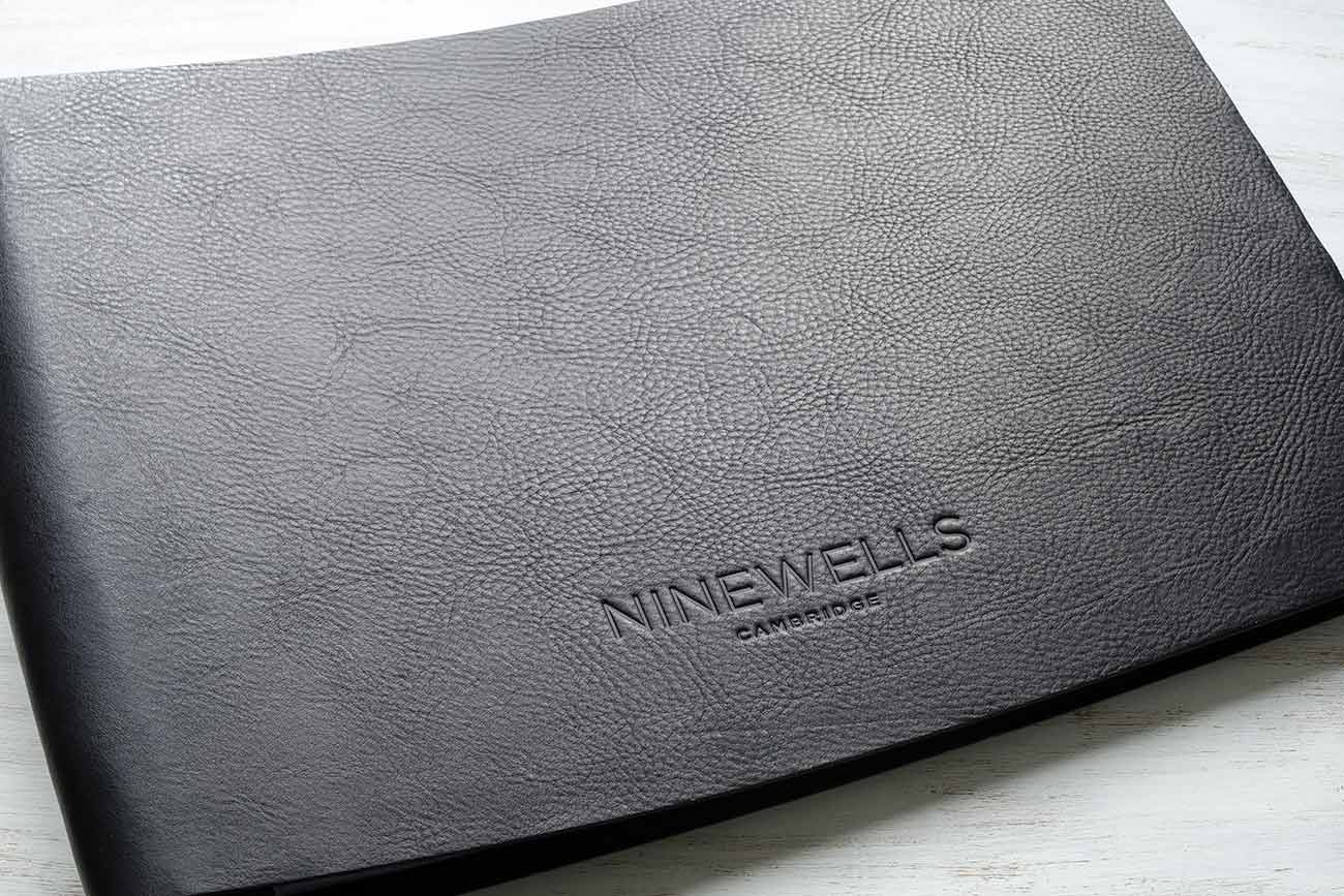 A3 leather property sales folder with blind embossed personalisation in black leather