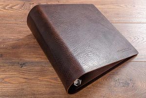 Large leather ring binder in dark brown leather with blind embossed front cover for a classic car