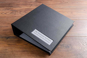 Emergency medicine medical portfolio in black faux leather with a name plaque matching the inner cover fabric and the name embossed in black foil