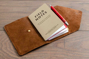 Leather Notebook Cover Holding Three A6 Field Notebooks and a Pen