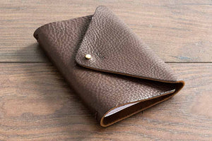 Brown Leather Notebook Cover Holding three A6 Notebooks