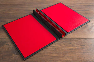 The inside cover of vehicle document binder is in Ruby red buckram