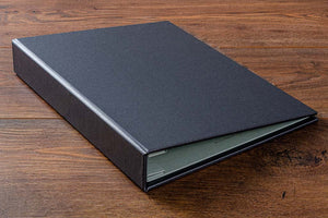 Case bound portfolio book in charcoal buckram