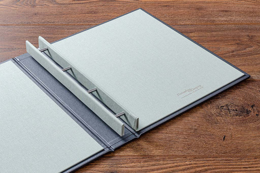 Personalised case bound portfolio book in charcoal buckram.