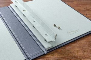 To put pages into the portfolio or to take them out, lift over the magnetic cover and simply undo the screw heads.