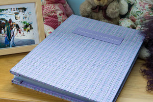 Childs scrapbook and memory keeper in specially supplied dress material for the cover and personalised name plaque