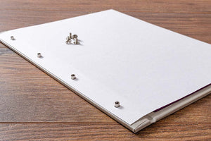 Place your page onto the cover. The screw post spacing is based on a standard 4 hole paper punch or in the case of US sizes, 3 hole.