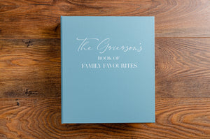 Luxury personalised recipe binder in blue buckram with white printed lettering The Book of Family Favourites