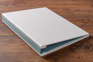 Hidden screw post presentation portfolio book in Pearl buckram.