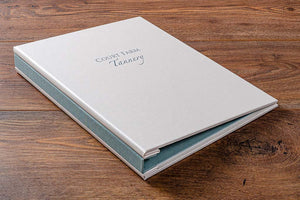 Hidden screw post presentation portfolio book in Pearl buckram with personalised front cover