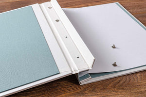 Taking the cover off the portfolio is quite straight forward, firstly lift over the cover and unscrew the screw post caps.