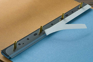 adhesive hinge strips for placing prints and paper into portfolios