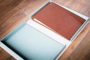 Leather wedding album inside clamshell storage box