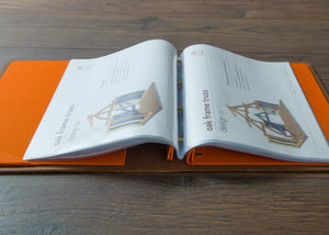 A4 leather portfolio book shown open with pages in sleeves laying flat