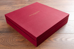 Square box with fitted lid in red book cloth and gold foil personalisation