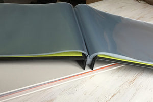 A3 portfolio book with page protectors open and flat