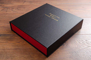 Vehicle document box file in black buckram with gold foil embossing on the cover with Jaguar E Type details
