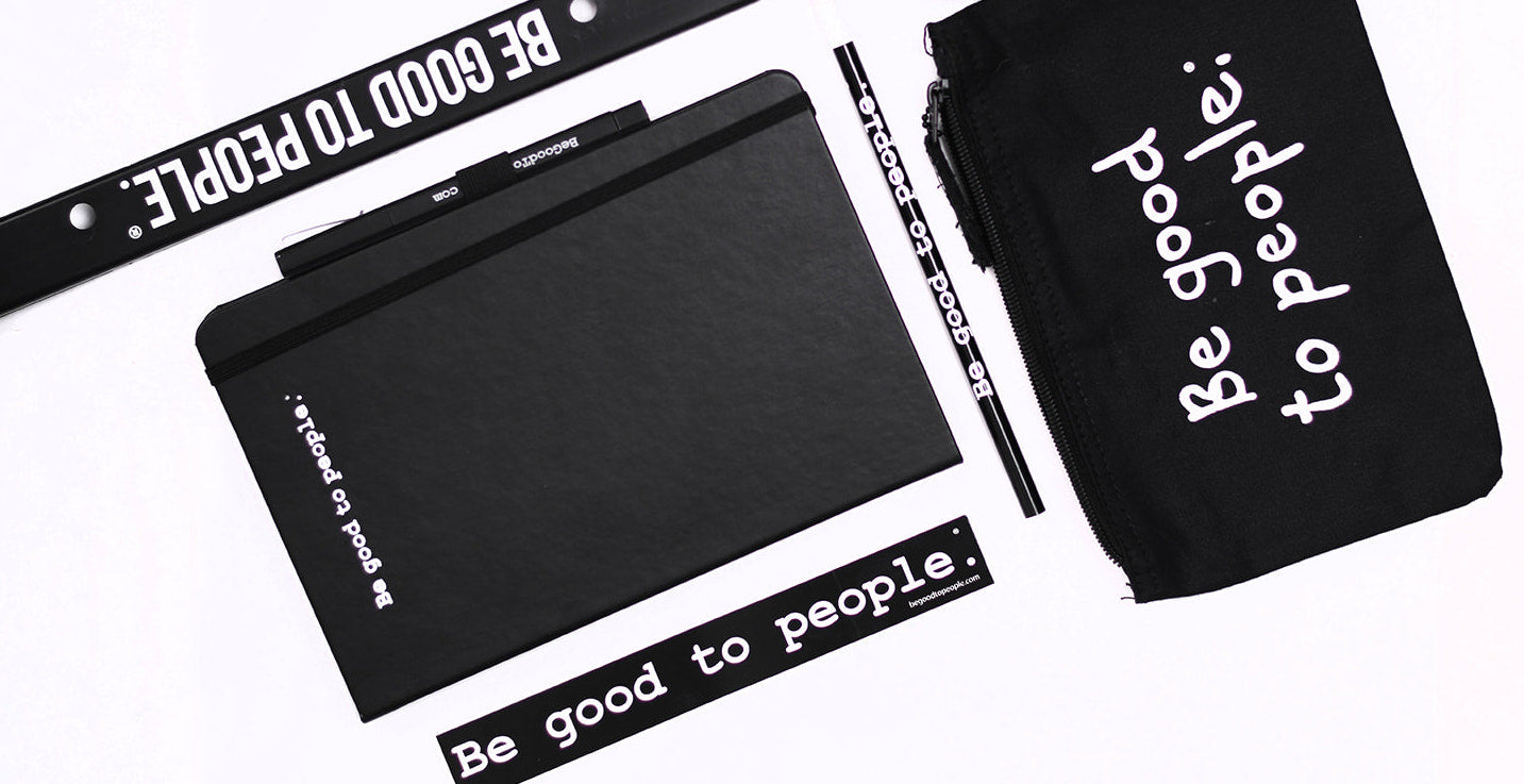 A layout featuring Be Good to People products including a Legacy License Plate Frame, A Classic Journal Set, A Classic Pencil, a Classic Slim Sticker and a Collection Zippered Clutch featuring our Signature logo.
