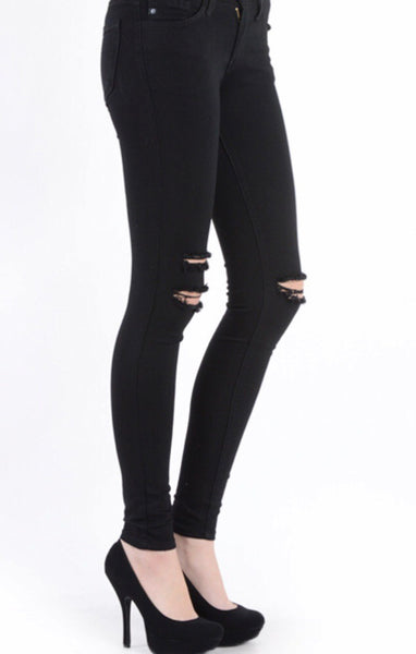 Distressed Black Skinnies