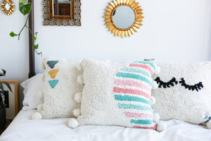 Washable pillow in cream, pink and teal with pom poms
