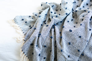 Blue decorative throw blanket with details