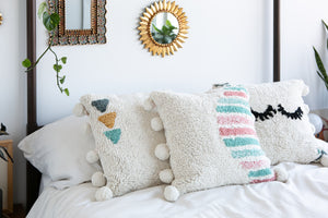 Washable pillow with eyelashes in cream and oink, teal and green accent colors