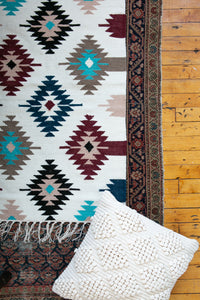 Small accent rug with blue designs
