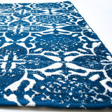 cozy, soft small area rug with blue floral pattern