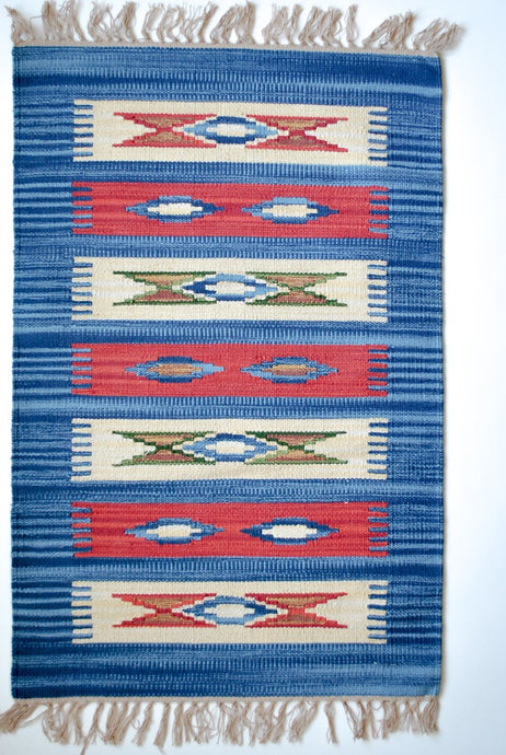 blue and red kilim rug with nomad motif