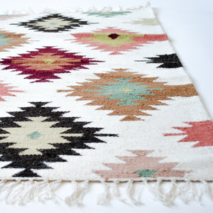 Neutral multi color small lilim accent rug