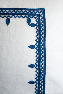vineyard white and blue accent pillow with embroidery