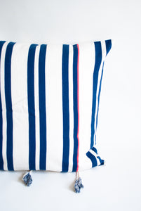 nantucket navy blue and pink striped pillow with tassels