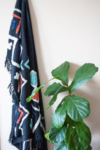 boho throw black with embellishments in orange and turquoise