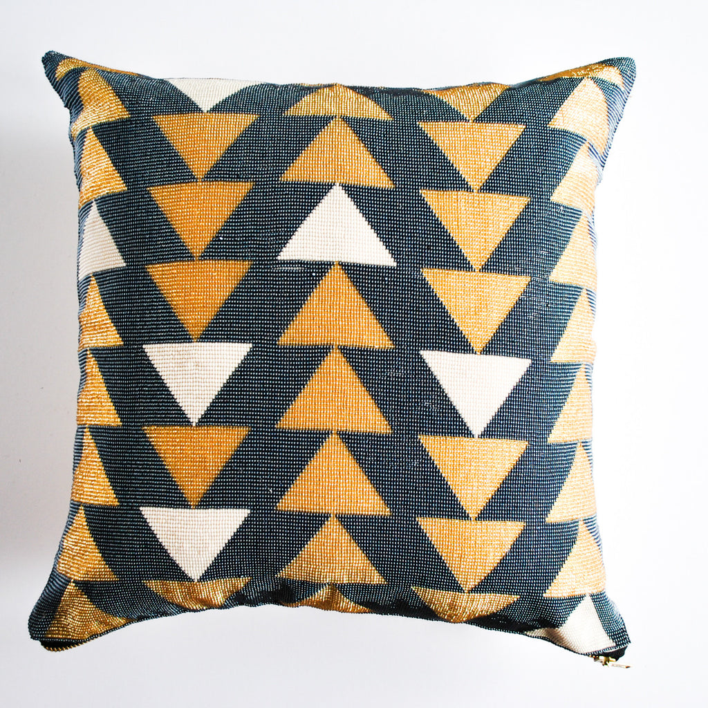 golden hand-beaded accent pillow with geometric pattern