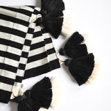 double pompom black and white striped accent throw