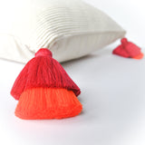 white peruvian accent pillow with double pink and orange tassel