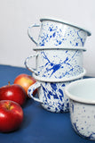 white and navy blue enamel coated coffee mug