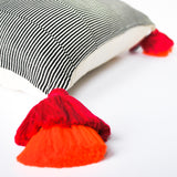 lumbar meraki home accent pillow with double pink and orange pom pons