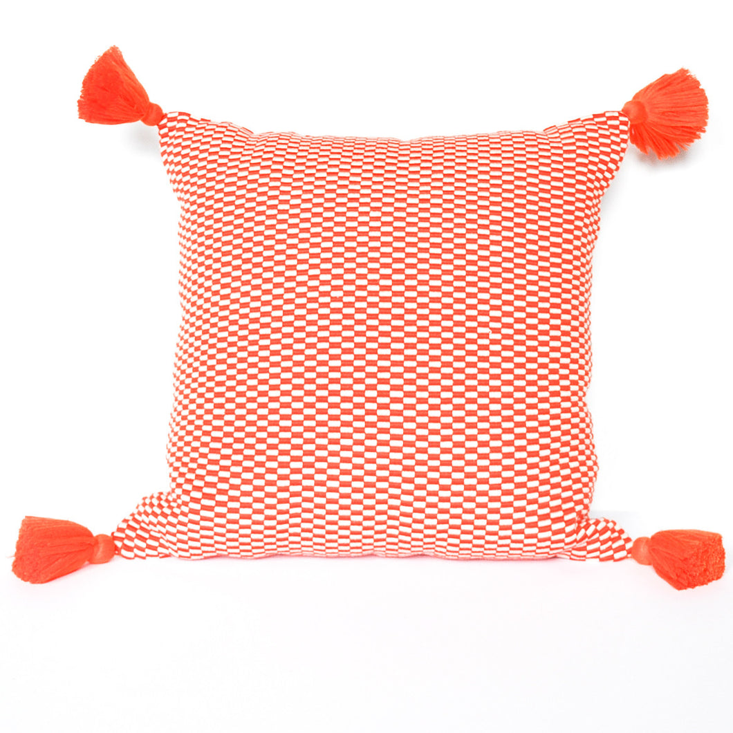orange handmade peruvian pillow with single orange tassel down insert