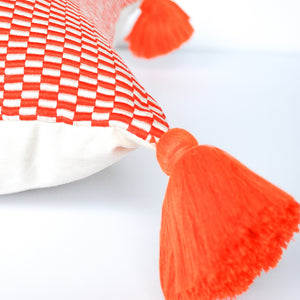 orange pillow with single orange tassel handmade in Peru