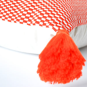 peruvian orange pillow with single orange tassel