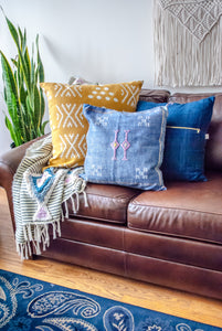 boho modern living room decoration displaying Sigrid & Co. Pillows and decoration with plants