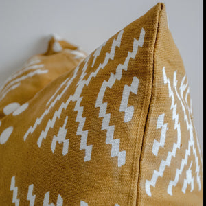 mustard throw pillow 24x24 with white motifs